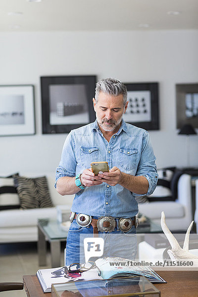 Caucasian man texting on cell phone