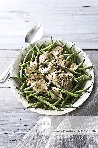Bowl of green beans and mushrooms