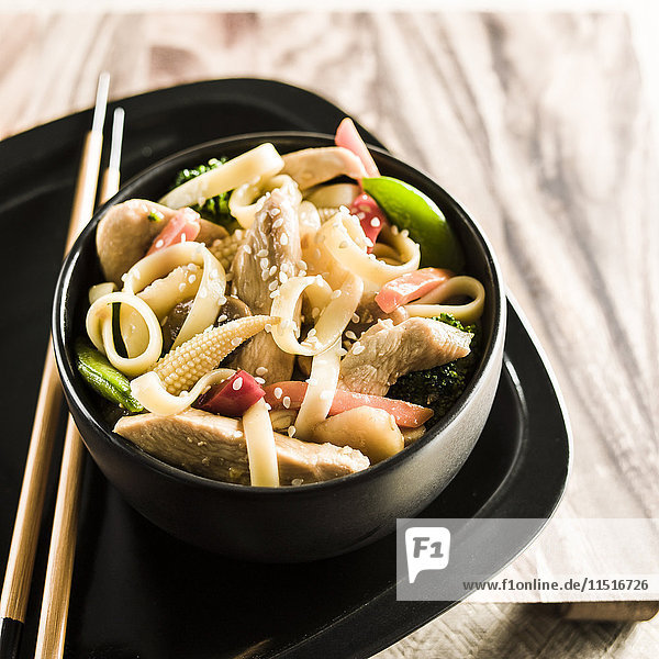 Bowl of stir fry chicken and vegetables