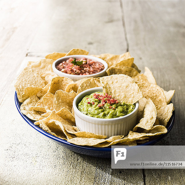 Bowl of chips with salsa and guacamole