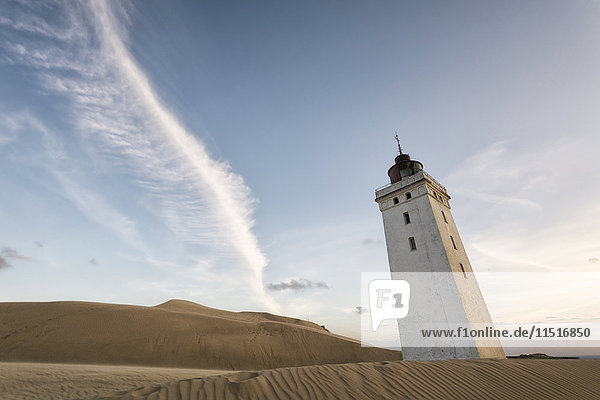 Remote tower leaning in sand dunes
