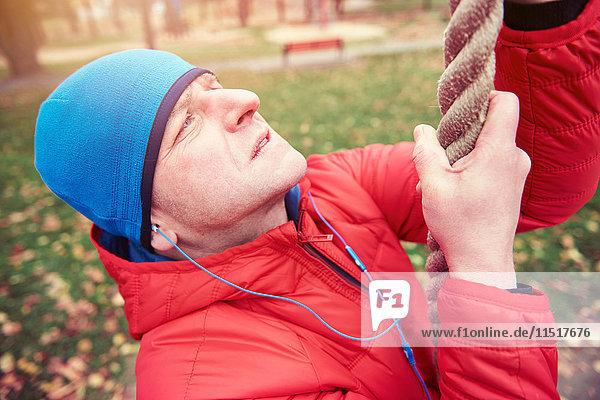 Mature man  outdoors  climbing rope