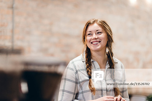 Happy young woman with pigtails