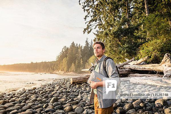 Man gazing from beach in Juan de Fuca Provincial Park  Vancouver Island  British Columbia  Canada