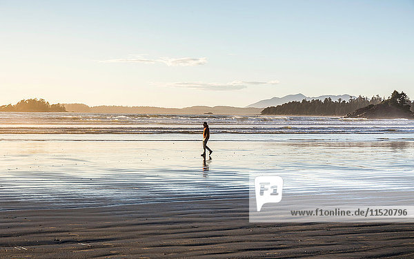 Man strolling on Long Beach at sunrise  Pacific Rim National Park  Vancouver Island  British Columbia  Canada