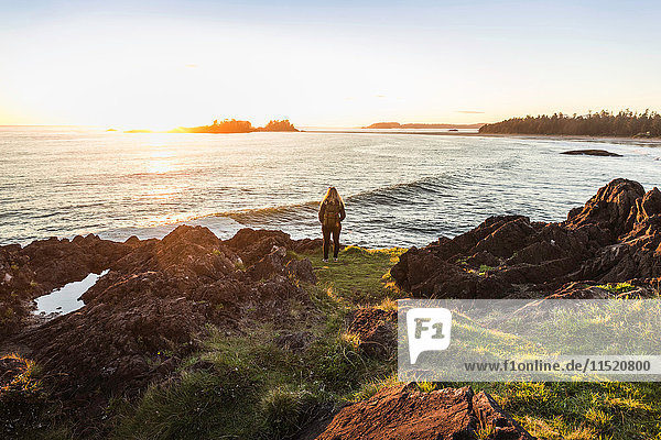 Woman watching sunset from coast  Pacific Rim National Park  Vancouver Island  British Columbia  Canada