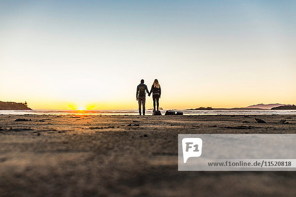 Couple watching sunset from Long Beach  Pacific Rim National Park  Vancouver Island  British Columbia  Canada