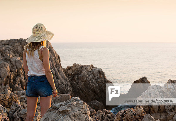 Rear view of woman looking at sea  Ciutadella  Menorca  Spain