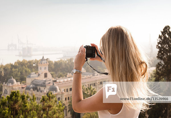 Woman with camera sightseeing  Malaga  Spain