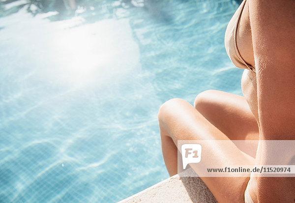Woman sitting on poolside  Torreblanca  Fuengirola  Spain