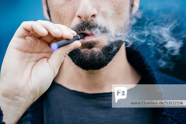 Portrait of man smoking an electronic cigarette