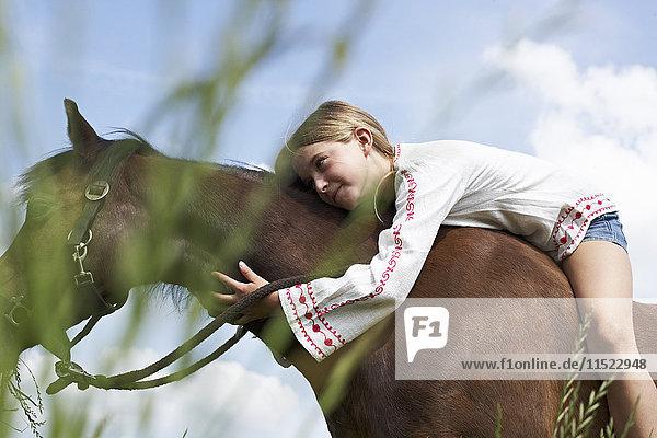 Girl lying on horseback
