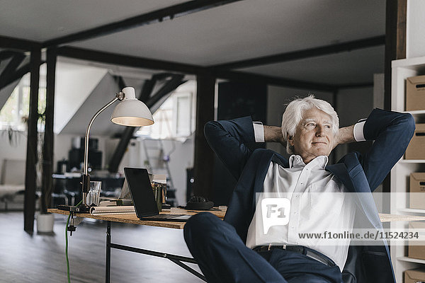 Senior businessman relaxing in his office