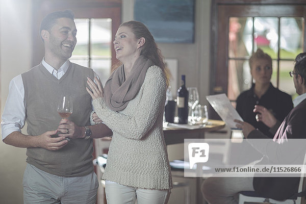 Happy couple with glass of wine
