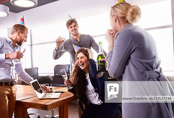 Business people drinking champagne  celebrating birthday in conference room