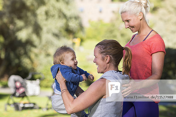 Women with baby boy in park