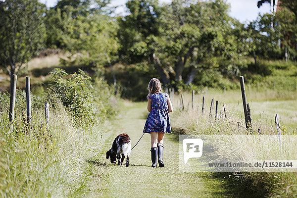 Girl walking dog