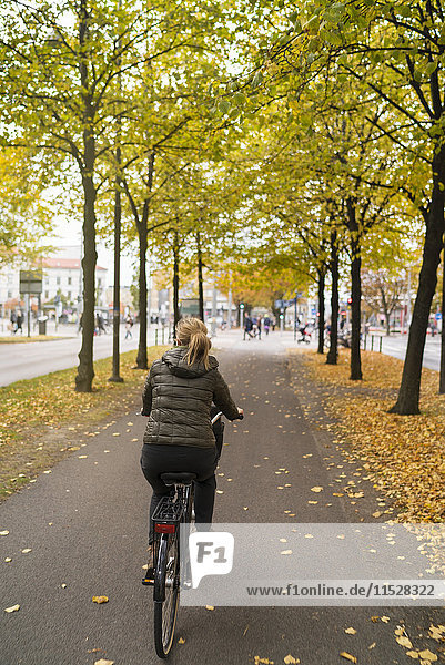 Woman cycling in town