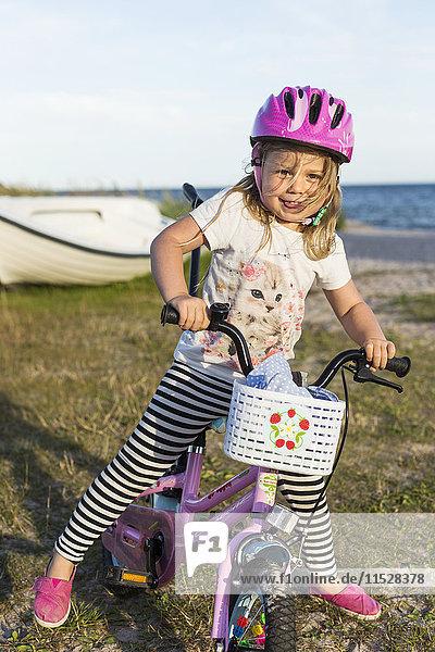 Girl on bike on beach