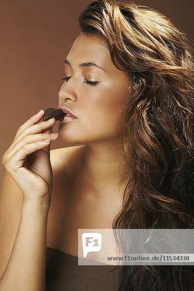 Woman Eating Chocolate
