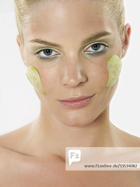 Cucumber Slices on Woman's Face
