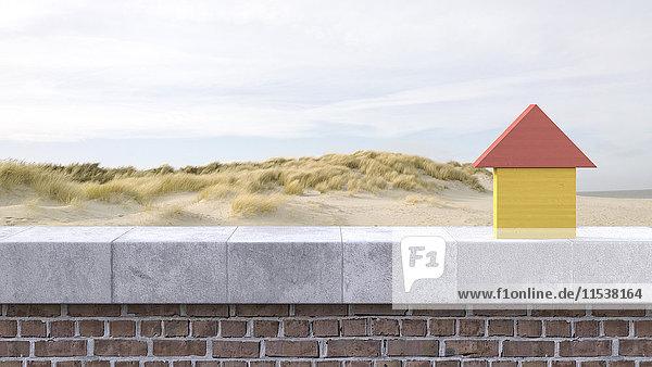 3D Rendering  Holzhaus auf Fensterbank  Strand im Hintergrund