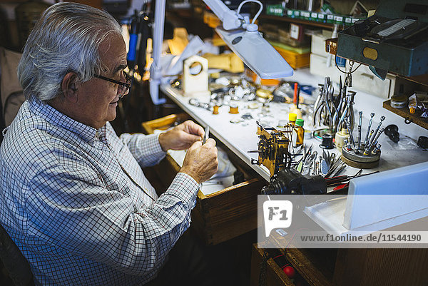 Watchmaker working in watchmaking