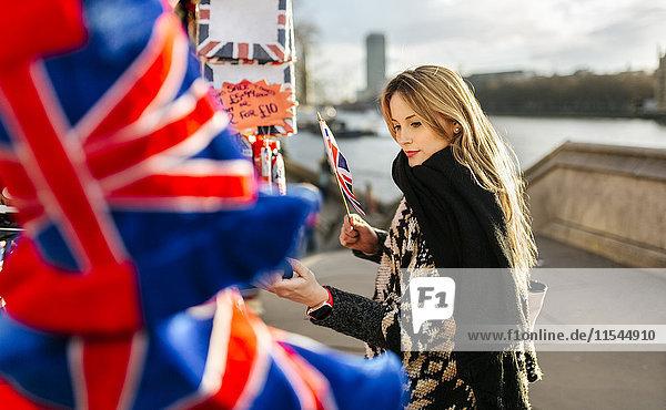 UK  London  young woman looking at a souvenir stall
