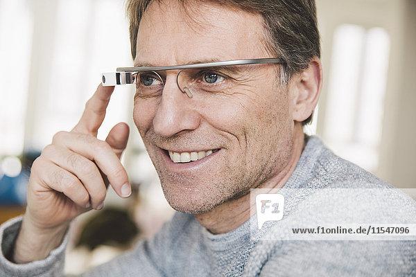 Smiling man wearing optical head-mounted display