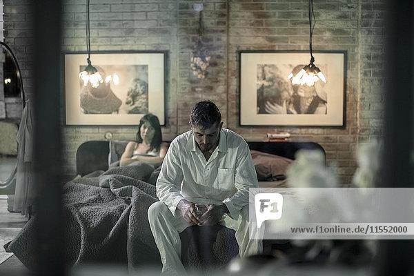 Couple in bedroom having an argument