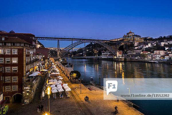 Portugal  Porto  Luiz I Bridge and Douro river  Mosteiro da Serra do Pilar in background in the evening