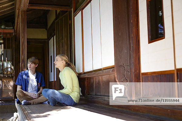 Caucasian couple at traditional Japanese house