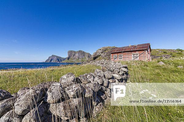 House of fishermen called rorbu surrounded by sea  Sorland  Vaeroy Island  Nordland county  Lofoten archipelago  Norway  Scandinavia  Europe
