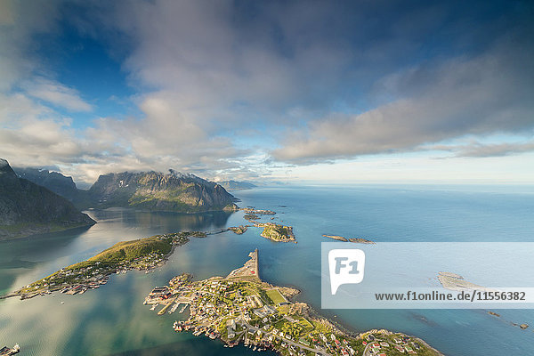 Blue sky and clouds frame the turquoise sea and the typical village  Reinebringen  Moskenesoya  Lofoten Islands  Norway  Scandinavia  Europe