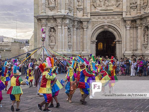 Masked dancers  Fiesta de la Virgen de la Soledad  Basilica of Our Lady of Solitude  Oaxaca  Mexico  North America