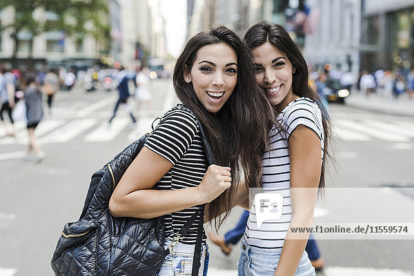 USA  New York City  two happy twin sisters in Manhattan