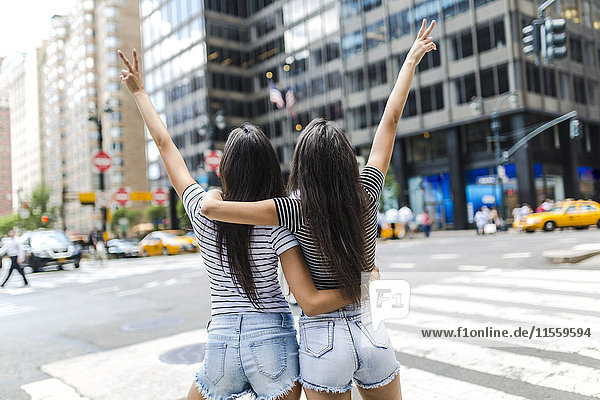 USA  New York City  back view of two young women in Manhattan having fun
