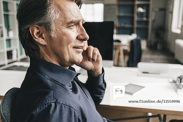 Mature businessman talking on cell phone