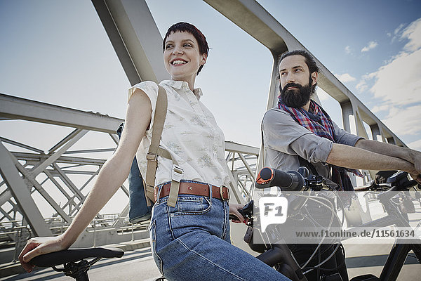 Germany  Hamburg  couple with electric bicycles on a bridge