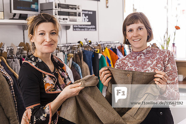 Portrait of two women in a second hand shop