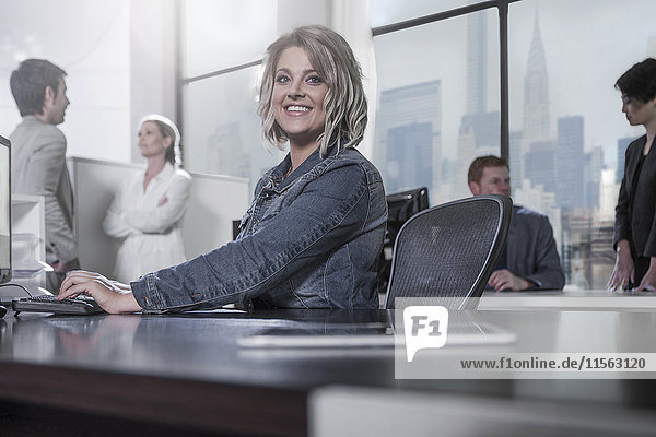 Smiling woman at desk in city office