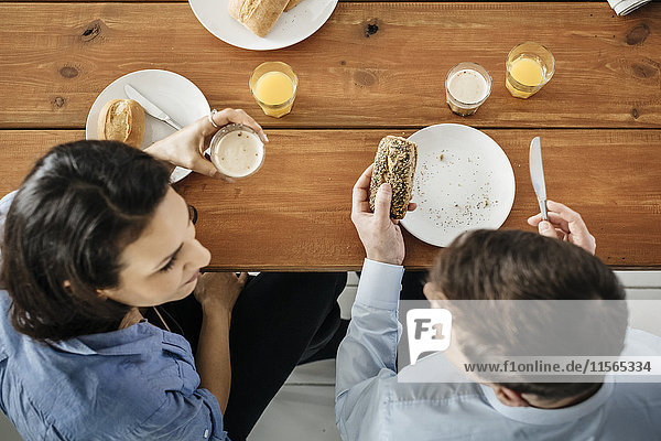 Germany  Couple eating breakfast at table