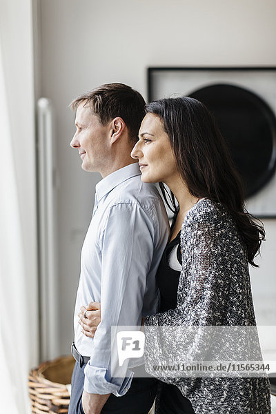 Germany  Couple hugging in living room