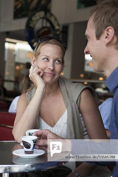 Couple having espresso in cafe