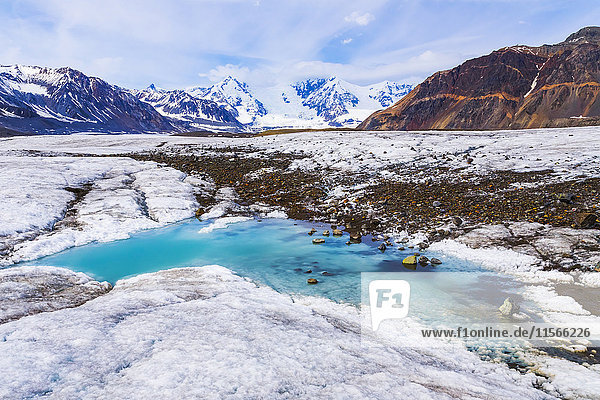 'A turquoise pool of water lies on the surface of Gakona Glacier in the Alaska Range; Alaska  United States of America'