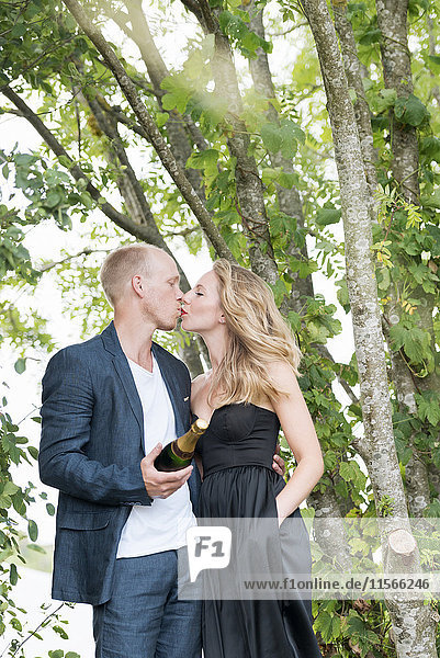 Young couple having champagne bottle