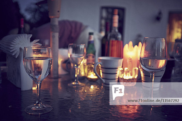 Wine glasses and candles on table