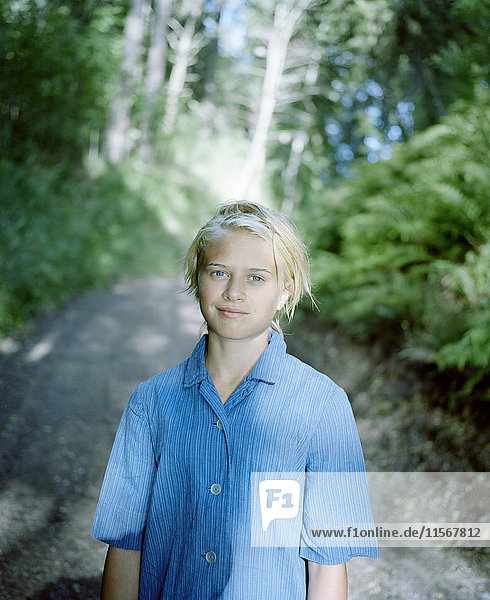 Portrait of blond girl in forest