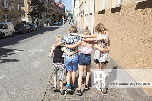 Children walking together down street