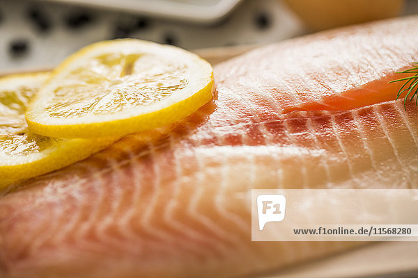 Close up of raw tilapia with slices of lemon